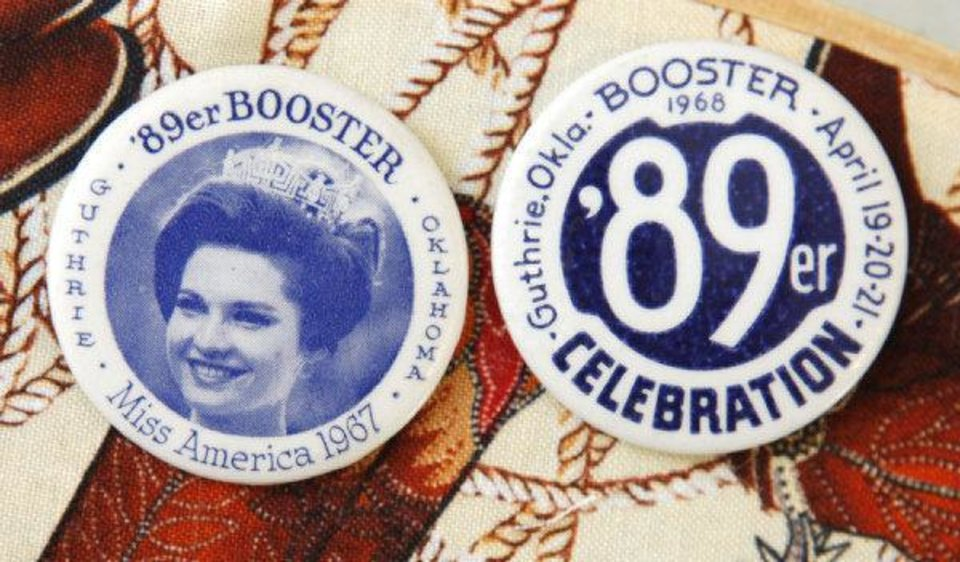 Photo - These are two of the buttons in an 89er Day button collection up for auction at the Logan County Fairgrounds as part of Guthrie's 89er Day festivities. PHOTO BY PAUL HELLSTERN, THE OKLAHOMAN