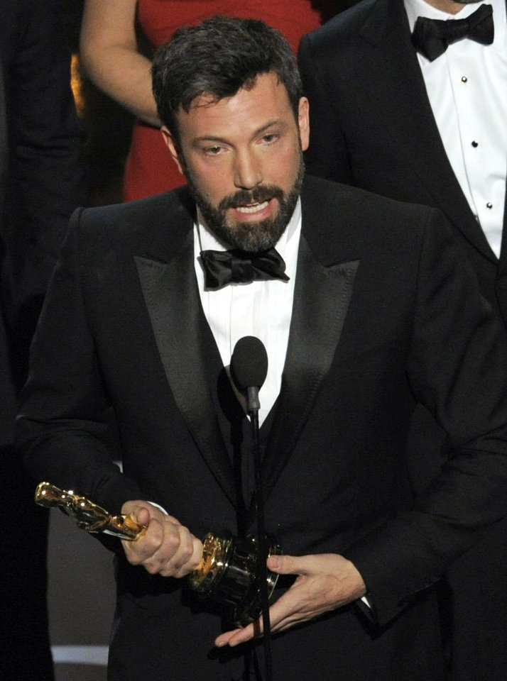 Photo - Director/producer Ben Affleck accepts the award for best picture for