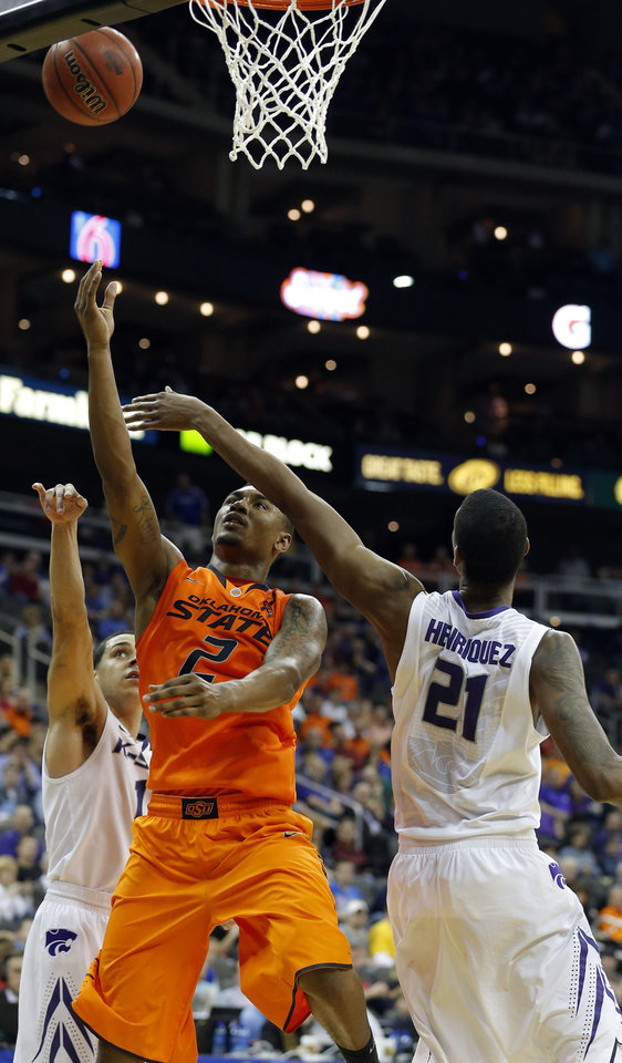 Oklahoma State\'s Le\'Bryan Nash (2) shoots in between Kansas State\'s Shane Southwell (1) and Kansas State\'s Jordan Henriquez (21) during the Phillips 66 Big 12 Men\'s basketball championship tournament game between Oklahoma State University and Kansas State at the Sprint Center in Kansas City, Friday, March 15, 2013. Photo by Sarah Phipps, The Oklahoman
