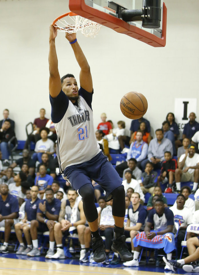 Photo - Oklahoma City's Andre Roberson dunks the ball during the Thunder's annual Blue and White Scrimmage at John Marshall Mid-High School in Oklahoma City, Tuesday, Sept. 27, 2016. Photo by Bryan Terry, The Oklahoman