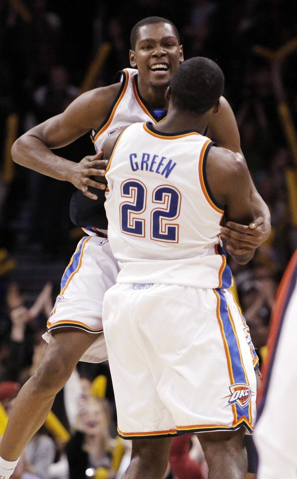 Photo - Oklahoma City's Kevin Durant (35) and Jeff Green (22) celebrate at the end of the NBA basketball game between the Oklahoma City Thunder and the Utah Jazz at the Ford Center in Oklahoma City, Thursday, December 31, 2009. The Thunder won, 87-86. Photo by Nate Billings, The Oklahoman
