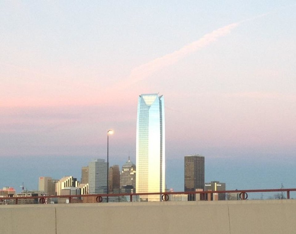 Devon tower from I-40. The colors are natural. Light orange to sky blue, almost Thunder colors. By the time I could stop and take the picture the colors had lost a little vibrancy, but still very nice.  Photo by Michale Murphy