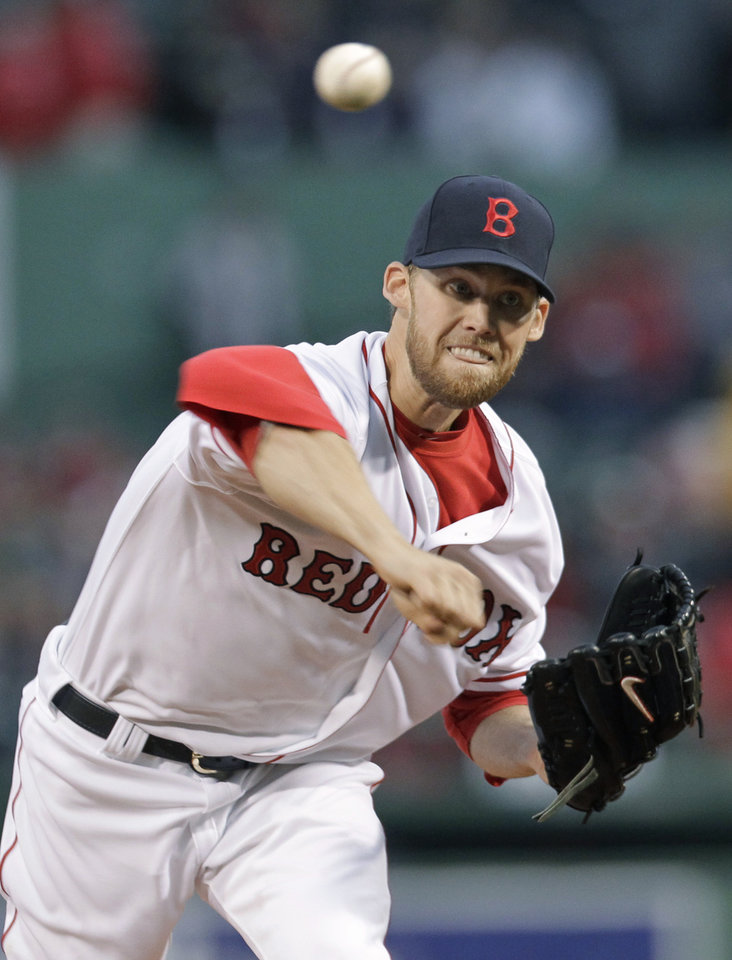 Photo -   Boston Red Sox starting pitcher Daniel Bard throws to an Oakland Athletics batter during the first inning of a baseball game at Fenway Park in Boston, Wednesday, May 2, 2012. (AP Photo/Elise Amendola)