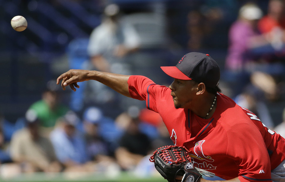 Photo - St. Louis Cardinals pitcher Carlos Martinez throws in the first inning of an exhibition spring training baseball game against the New York Mets, Wednesday, March 12, 2014, in Port St. Lucie, Fla. (AP Photo/David Goldman)
