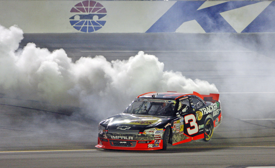 Photo -   Austin Dillon does a burnout after winning the NASCAR Nationwide Series auto race at Kentucky Speedway in Sparta, Ky., Friday, June 29, 2012. AP Photo/Bud Kraft)