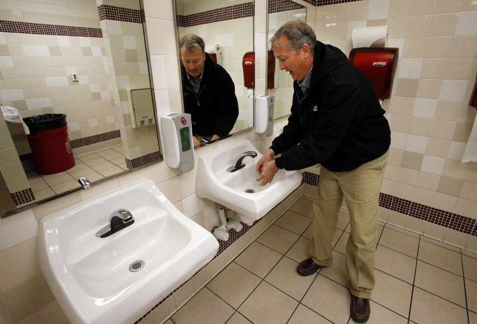 University of Oklahoma facilities manager Brian Ellis shows low flow faucets in bathrooms at McCasland Field House as he shows energy saving enhancements to the Norman campus on Tuesday, Nov. 27, 2012 in Norman, Okla.  Photo by Steve Sisney