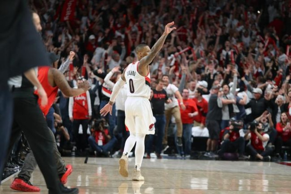 Photo -  Damian Lillard waves good-bye to Thunder bench after his 3-pointer at the buzzer gave the Trail Blazers a 118-115 series-clinching win Tuesday in Portland. [Sean Meagher/The Oregonian via AP]