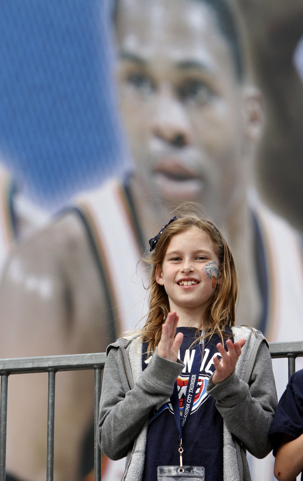 Perri Lewis, 9, of Oklahoma City cheers before the first round NBA basketball playoff game between the Oklahoma City Thunder and the Denver Nuggets on Wednesday, April 20, 2011, at the Oklahoma City Arena. Photo by Sarah Phipps, The Oklahoman