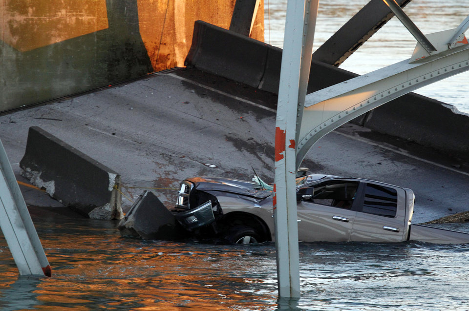 Photo - A truck is seen in the water after a portion of the Interstate 5 bridge collapsed into the Skagit River in Mount Vernon, Wash., Thursday, May 23, 2013. (AP Photo/Everett Daily Herald, Jennifer Buchanan)