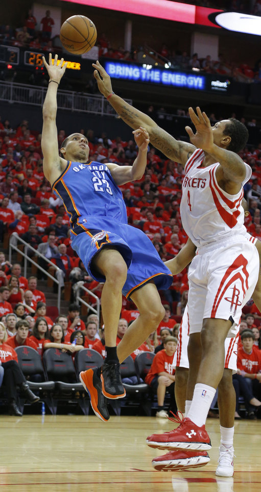 Oklahoma City's Kevin Martin (23) shoots the ball beside Houston's Greg Smith (4) during Game 6 in the first round of the NBA playoffs between the Oklahoma City Thunder and the Houston Rockets at the Toyota Center in Houston, Texas, Friday, May 3, 2013. Oklahoma City won 103-94. Photo by Bryan Terry, The Oklahoman