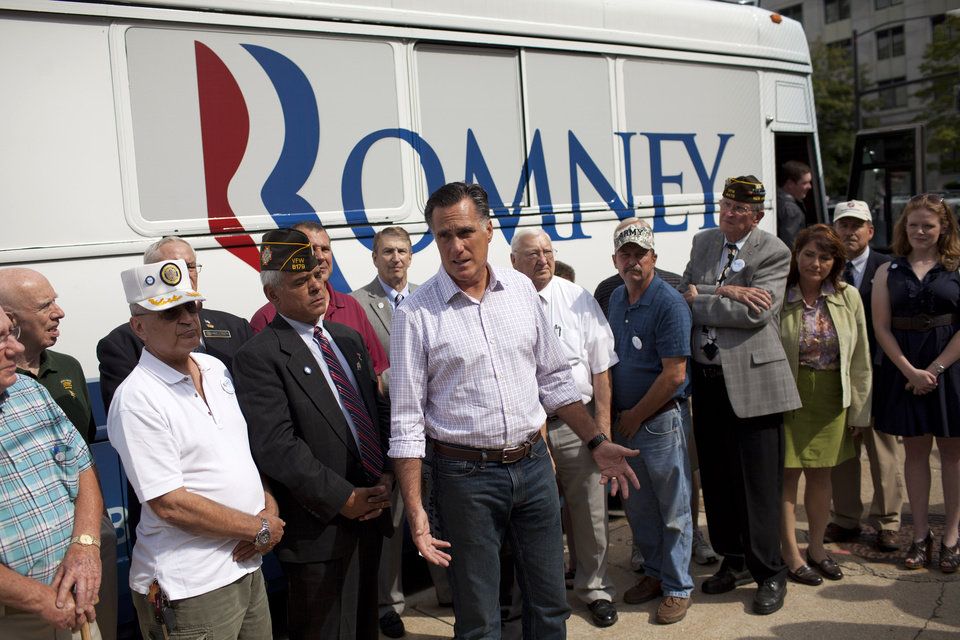Photo -   Republican presidential candidate, former Massachusetts Gov. Mitt Romney speaks with the news media after making a stop at the