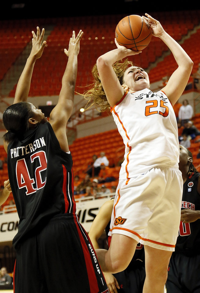 Oklahoma State's Lindsey Keller (25) shoots against Texas Tech's Jackie Patterson (42) during a women's college basketball game between Oklahoma State University (OSU) and Texas Tech at Gallagher-Iba Arena in Stillwater, Okla., Wednesday, Jan. 2, 2013. Texas Tech won, 64-59.  Photo by Nate Billings, The Oklahoman