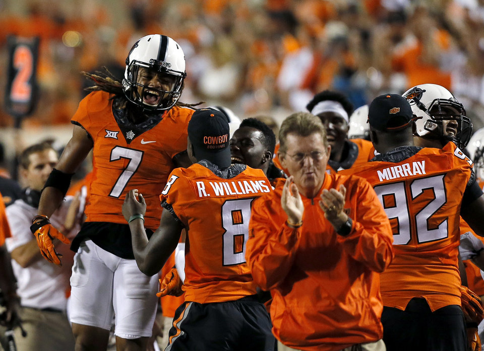 Photo - Oklahoma State's Ramon Richards (7) celebrates his interception in the final minute of the game during a college football game between the Oklahoma State Cowboys (OSU) and the Pitt Panthers at Boone Pickens Stadium in Stillwater, Okla., Saturday, Sept. 17, 2016. Photo by Sarah Phipps, The Oklahoman