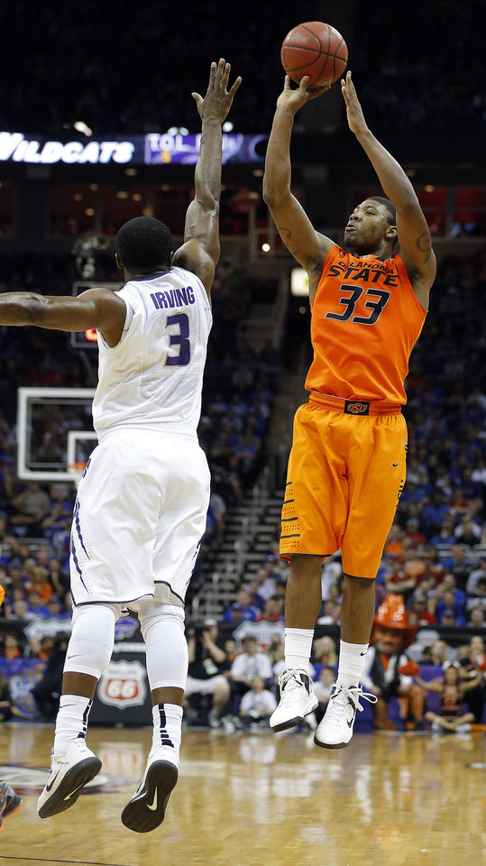 Oklahoma State's Marcus Smart (33) shoots over Kansas State's Martavious Irving (3) during the Phillips 66 Big 12 Men's basketball championship tournament game between Oklahoma State University and Kansas State at the Sprint Center in Kansas City, Friday, March 15, 2013. Photo by Sarah Phipps, The Oklahoman