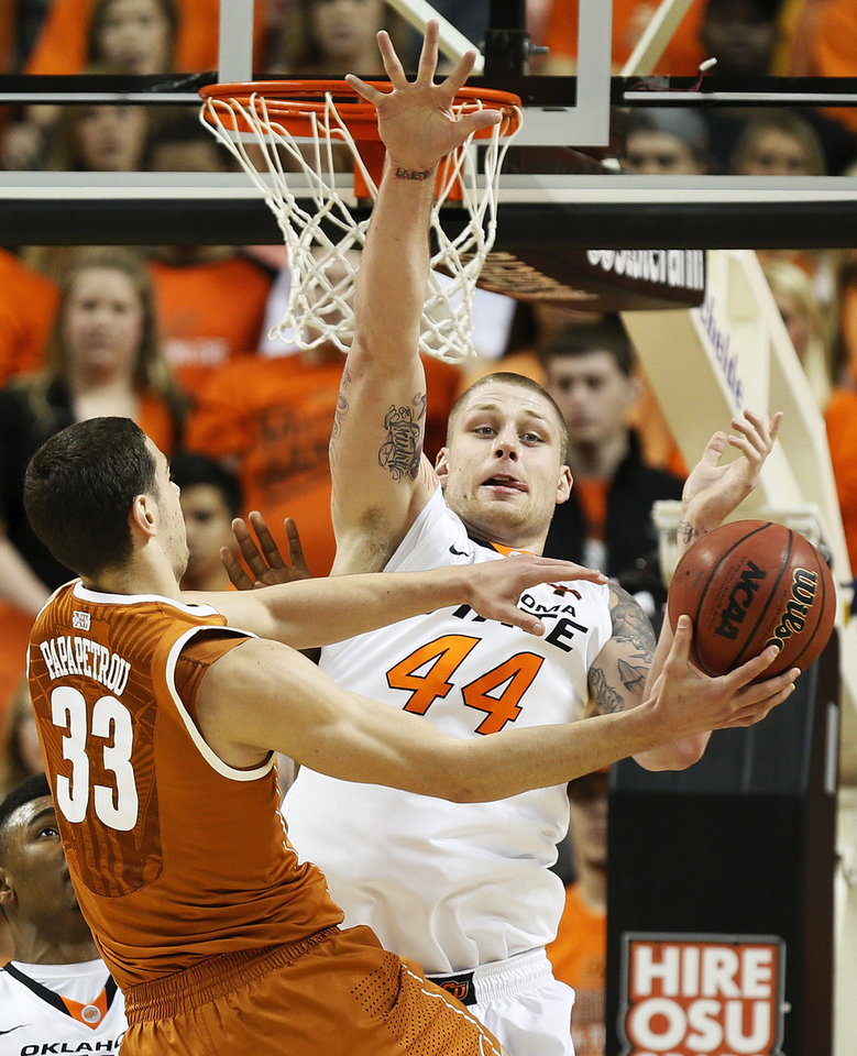 Oklahoma State\'s Philip Jurick (44) defends a shot by Texas\' Ioannis Papapetrou (33) during a men\'s college basketball game between Oklahoma State University (OSU) and the University of Texas at Gallagher-Iba Arena in Stillwater, Okla., Saturday, March 2, 2013. Photo by Nate Billings, The Oklahoman
