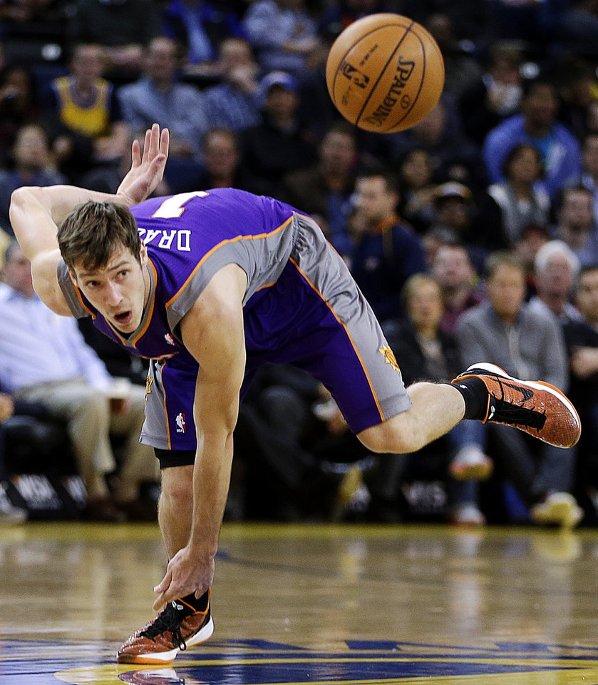 Phoenix Sun's Goran Dragic eyes a loose ball during the first half of an NBA basketball game against the Golden State Warriors, Wednesday, Feb. 20, 2013, in Oakland, Calif. (AP Photo/Ben Margot)