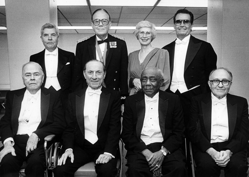 Photo - Joining the OKlahoma Hall of Fame during ceremonies downtown at Myriad Convention Center are, from left, front, Lyle H. Boren, Julian J. Rothbaum, James E. Stewart and Henry Zarrow; back, G. Rainey Williams, M.D., Charles P. Brown, Nancy Frantz Davies, and James Garner. Staff photo by Paul S. Howell, 11/14/1986.