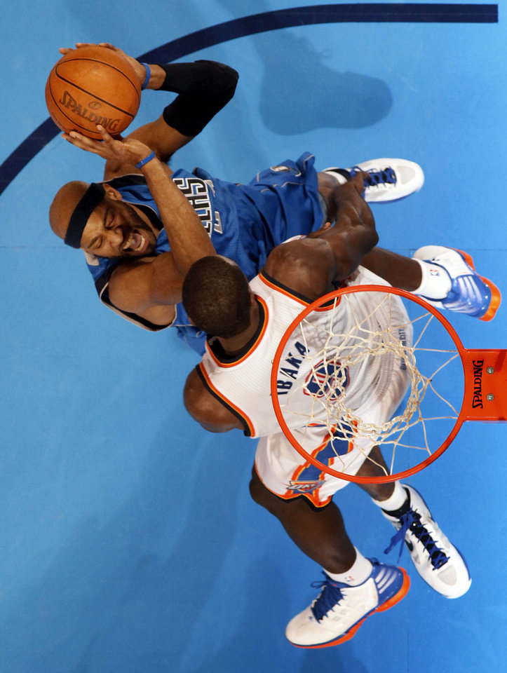 Dallas' Vince Carter (25) tries to score against Oklahoma City's Serge Ibaka (9) during game one of the first round in the NBA playoffs between the Oklahoma City Thunder and the Dallas Mavericks at Chesapeake Energy Arena in Oklahoma City, Saturday, April 28, 2012. Oklahoma City won, 99-98. Photo by Nate Billings, The Oklahoman