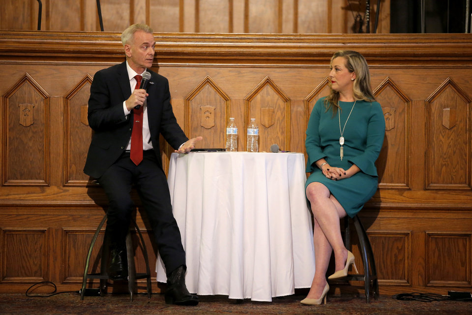Photo -  U.S Rep. Steve Russell speaks as Kendra Horn listens Wednesday during a debate between the two House 5th District candidates inside City Presbyterian Church in Oklahoma City. [Photo by Bryan Terry, The Oklahoman]