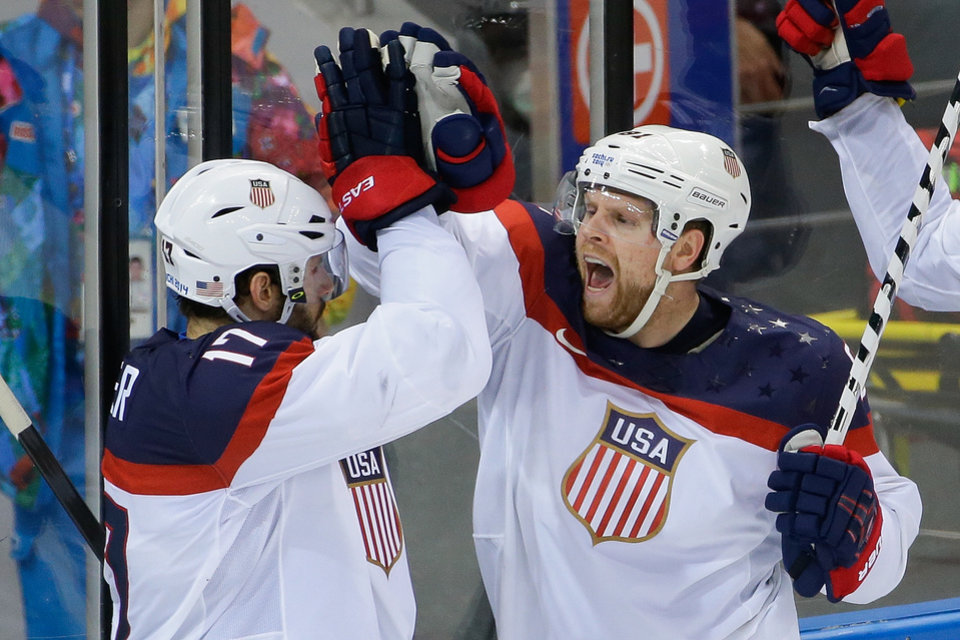 Photo - USA forward Phil Kessel, right, reacts to his goal with teammate Ryan Kesler during the third period of men's quarterfinal hockey game against the Czech Republic in Shayba Arena at the 2014 Winter Olympics, Wednesday, Feb. 19, 2014, in Sochi, Russia. (AP Photo/Matt Slocum)