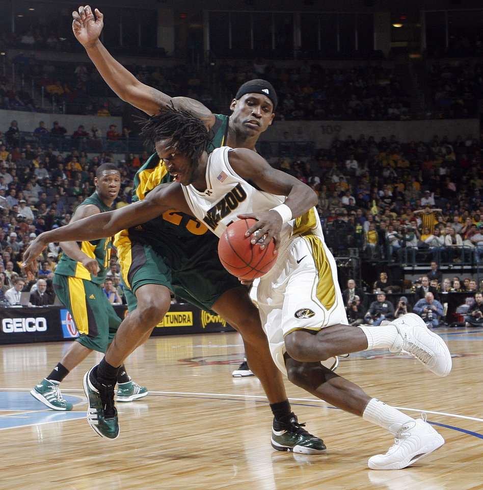 Missouri's DeMarre Carroll (1) drives past Baylor's Kevin Rogers (23) in the Championship game of the Big 12 Men's Basketball Championships between Baylor University and The University of Missouri at the Ford Center on Saturday, March 14, 2009, in Oklahoma City, Okla.