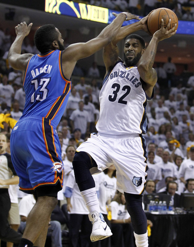 Photo - Memphis Grizzlies guard O.J. Mayo (32) drives against Oklahoma City Thunder guard James Harden (13) during the first half of Game 4 of a second-round NBA basketball playoff series on Monday, May 9, 2011, in Memphis, Tenn. (AP Photo/Wade Payne)