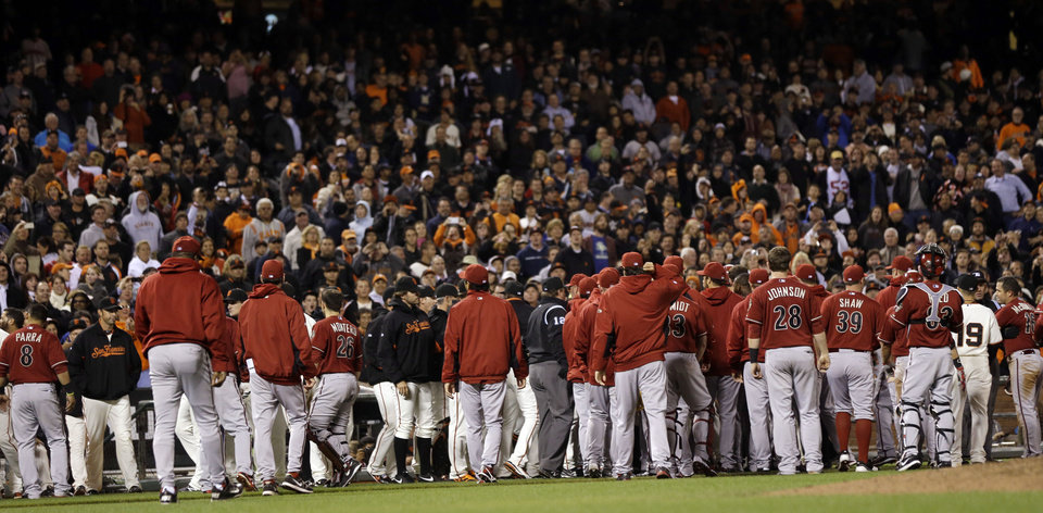Photo -   The Arizona Diamondbacks and San Francisco Giants benches clear after a collision between Giants third baseman Pablo Sandoval and Diamondbacks' John McDonald during the eighth inning of a baseball game on, Wednesday, Sept. 5, 2012 in San Francisco. (AP Photo/Marcio Jose Sanchez)