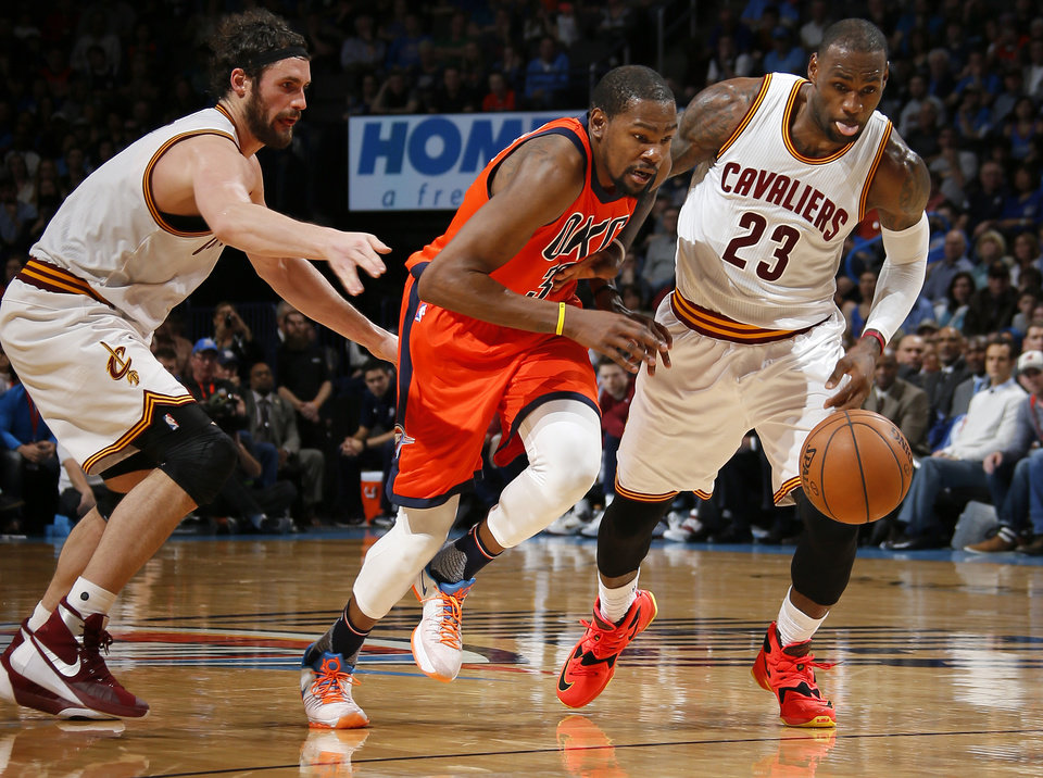 Photo - Oklahoma City's Kevin Durant (35) loses the ball between Cleveland's LeBron James (23) and Kevin Love (0) during an NBA basketball game between the Oklahoma City Thunder and the Cleveland Cavaliers at Chesapeake Energy Arena in Oklahoma City, Sunday, Feb. 21, 2016. Photo by Bryan Terry, The Oklahoman