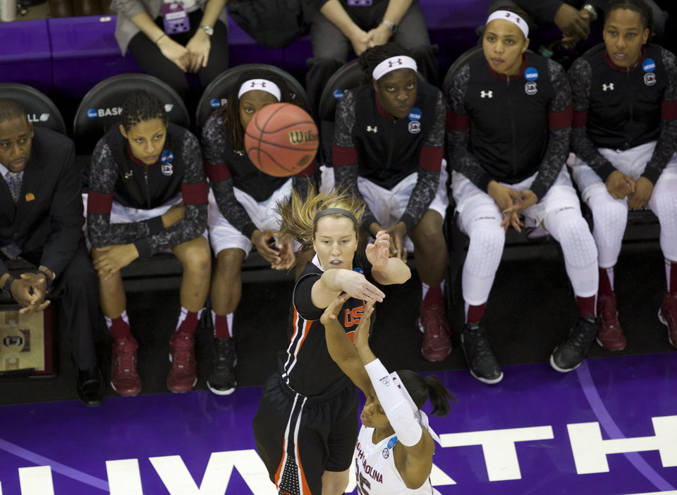 Photo - Oregon State guard Ali Gibson shoots over South Carolina guard Tiffany Mitchell (25) during the first half of a second-round game of the NCAA women's college basketball tournament, Tuesday, March 25, 2014, in Seattle. (AP Photo/The Oregonian, Randy L Rasmussen) MAGS OUT, TV OUT, LOCAL TV AND INTERNET OUT, (THE MERCURY, WILLAMETTE WEEK, PAMPLIN MEDIA GROUP OUT)