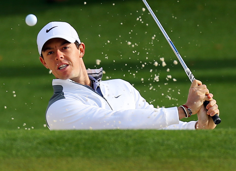 Photo - Rory McIlroy, of Northern Ireland, hits from the sand trap to the second green during practice for the Masters golf tournament Tuesday, April 8, 2014 in Augusta, Ga.  (AP Photo/Atlanta Journal-Constitution, Curtis Compton)  MARIETTA DAILY OUT; GWINNETT DAILY POST OUT; LOCAL TV OUT; WXIA-TV OUT; WGCL-TV OUT