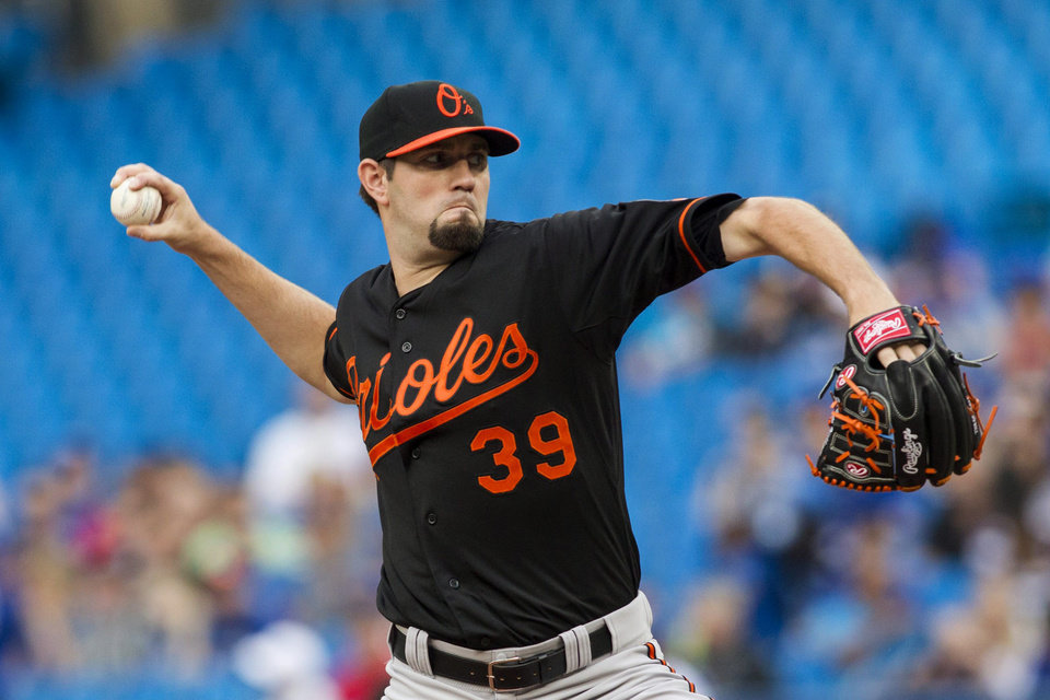 Photo - Baltimore Orioles starting pitcher Jason Hammel works against Toronto Blue Jays during the first inning of a baseball game in Toronto on Friday, June 21, 2013. (AP Photo/The Canadian Press, Chris Young)