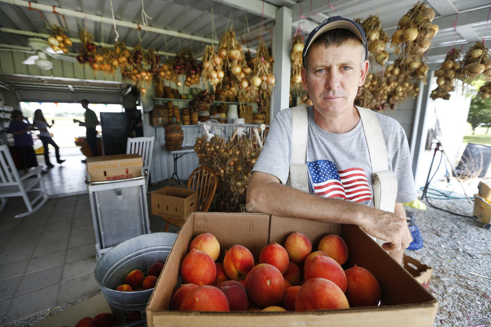 Peach Tree Farms owner Tim Blackburn poses for a photo in Stratford, Thursday July 18, 2013. Photo By Steve Gooch, The Oklahoman