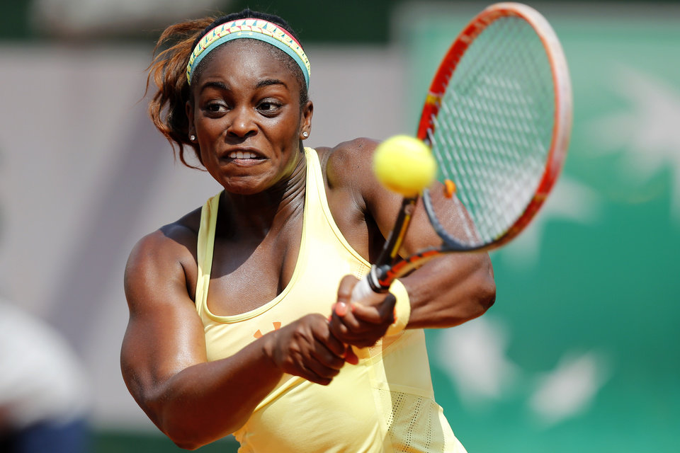 Photo - Sloane Stephens of the U.S. returns the ball during the third round match of the French Open tennis tournament against Russia's Ekaterina Makarova at the Roland Garros stadium, in Paris, France, Saturday, May 31, 2014. Stephens won on two sets 6-3, 6-4. (AP Photo/David Vincent)