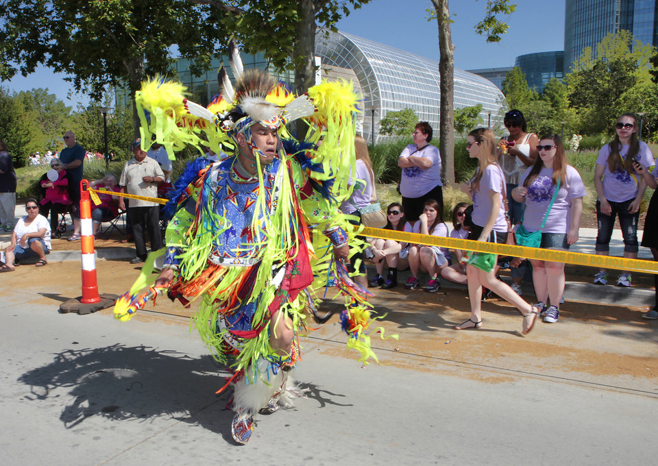 Arapaho/Cheyenne fancy dancer J.R. Lonelodge dances during the parade, Friday, June 7, 2013. Photo by David McDaniel, The Oklahoman