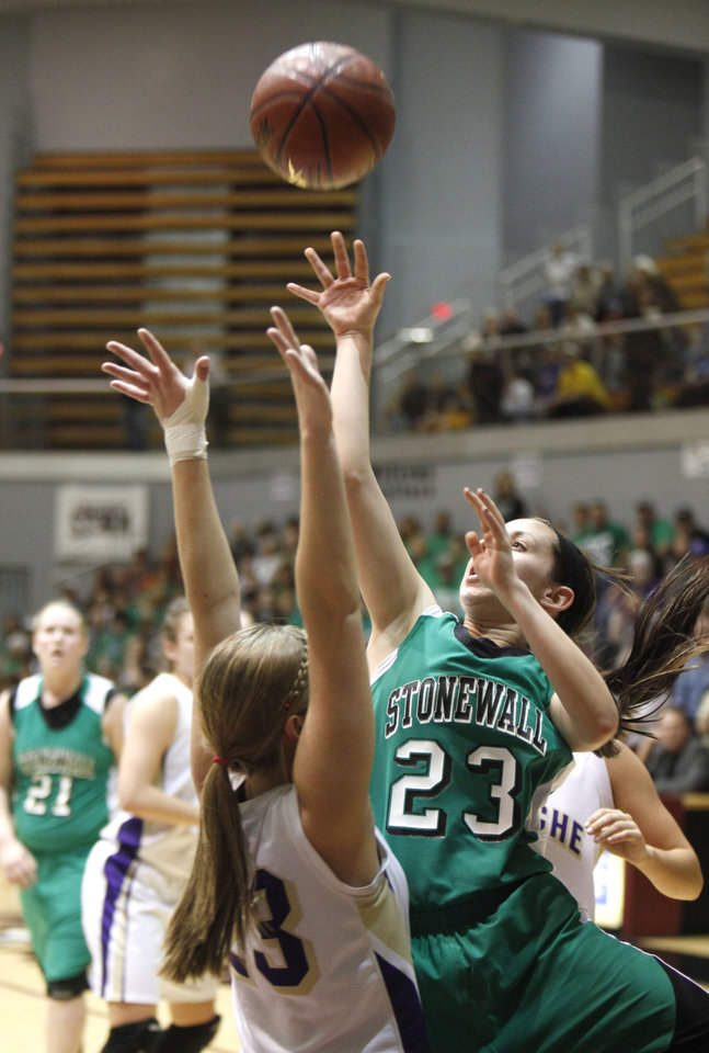 Photo - Stonewall's Bradianne Daniel takes a shot over Okarche's Kinsey Grellner during the girl's class A basketball playoffs at Southern Nazarene University's Sawyer Center in Bethany, OK, Thursday, March 1, 2012. By Paul Hellstern, The Oklahoman