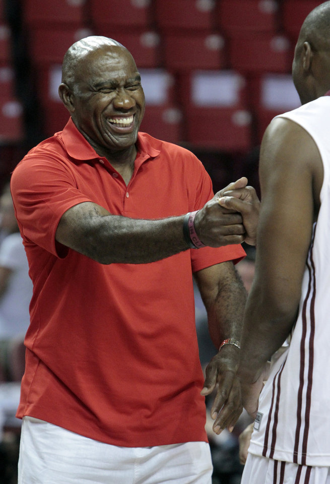 Photo - Garfield Heard, player from the 1960s, in introduced as the University of Oklahoma Sooners (OU) basketball alumni play at The Lloyd Noble Center on Saturday, Aug. 24, 2013  in Norman, Okla. Photo by Steve Sisney, The Oklahoman