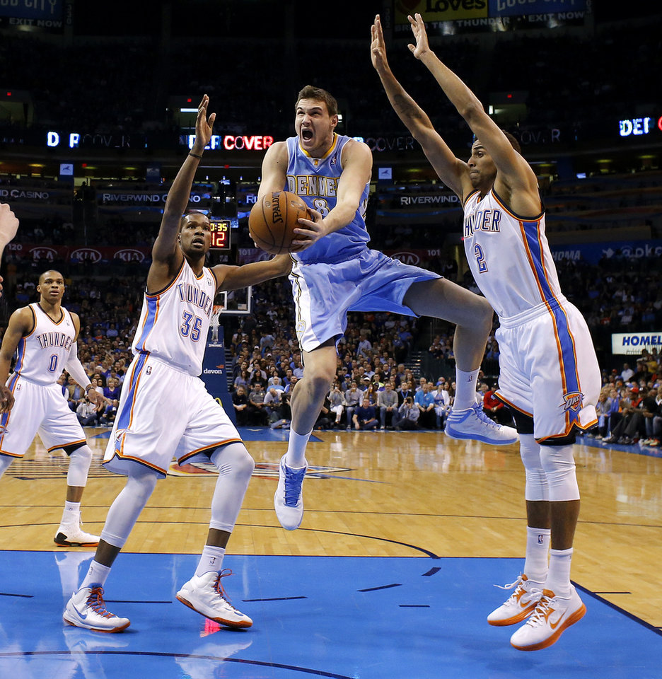 Denver\'s Danilo Gallinari (8) goes to the basket between Oklahoma City\'s Kevin Durant (35) and Thabo Sefolosha (2) during an NBA basketball game between the Oklahoma City Thunder and the Denver Nuggets at Chesapeake Energy Arena in Oklahoma City, Tuesday, March 19, 2013. Denver won 114-104. Photo by Bryan Terry, The Oklahoman