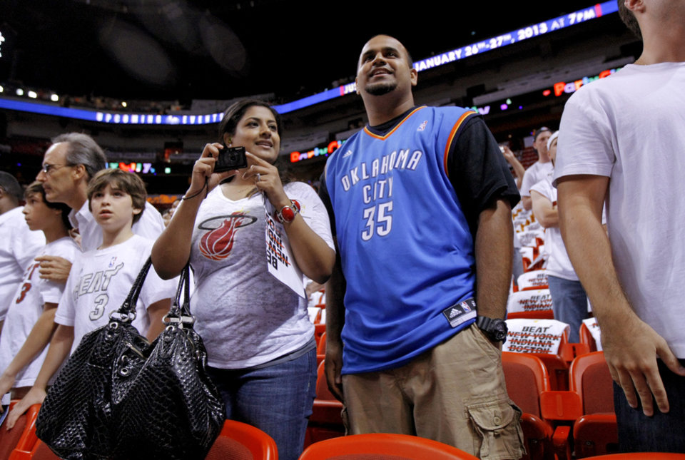 Photo - Nauza Ishmael, left, and Aameel Mohammed of Miami watch the Thunder warm up prior to Game 3 of the NBA Finals between the Oklahoma City Thunder and the Miami Heat at American Airlines Arena, Sunday, June 17, 2012. Photo by Bryan Terry, The Oklahoman