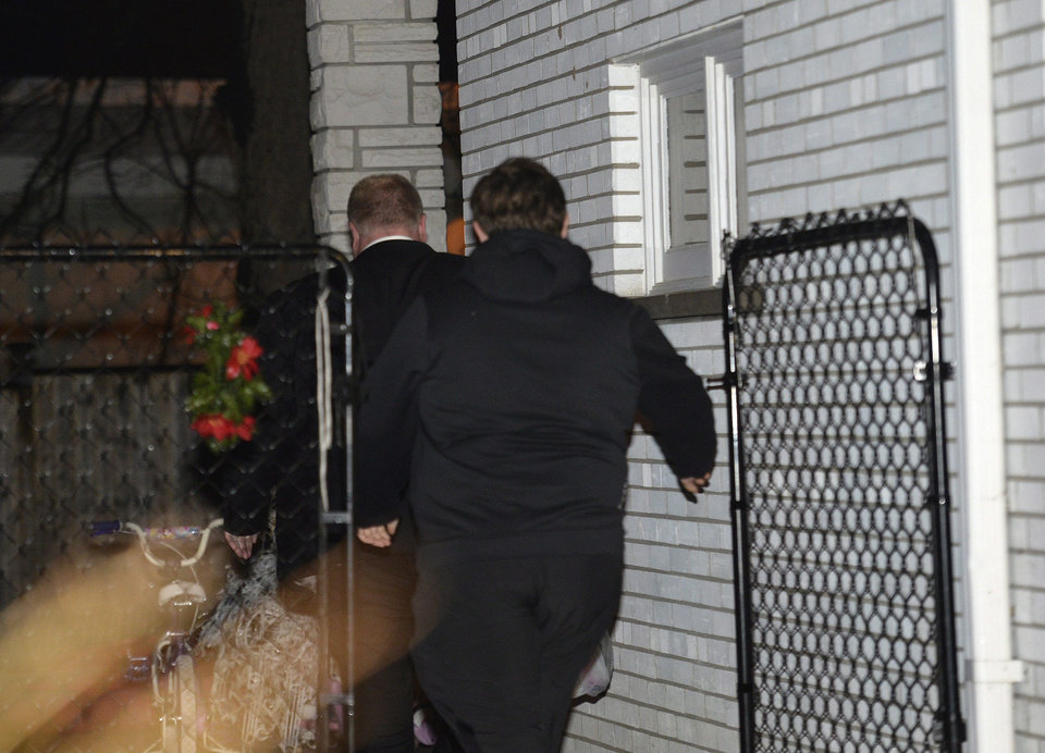 Photo - Toronto mayor Rob Ford, left, arrives at his home in Toronto early Thursday May 1, 2014. After maintaining for months that he is not an addict or an alcoholic, Rob Ford announced Wednesday he is seeking help for substance abuse, even as media reports emerged with new drug and alcohol allegations. (AP Photo/The Canadian Press, Nathan Denette)