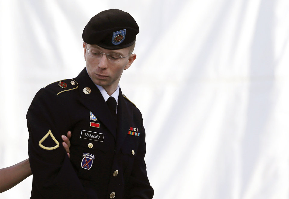Army Pfc. Bradley Manning is escorted into a courthouse in Fort Meade, Md., Wednesday, June 5, 2013, on the third day of his court martial. Manning is charged with indirectly aiding the enemy by sending troves of classified material to WikiLeaks. He faces up to life in prison. (AP Photo/Patrick Semansky)