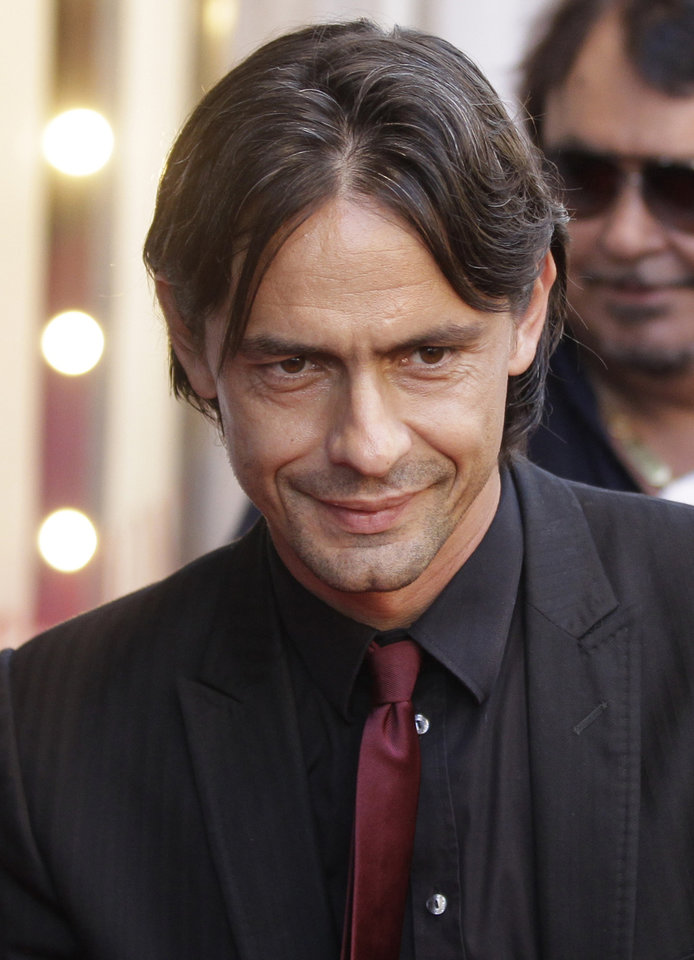 Photo - FILE - In this Thursday, May 19, 2011 file photo, AC Milan forward Filippo Inzaghi arrives on the red carpet to attend the presentation of a portraits book ' Milan Fashion , soccer players portraits' sponsorized by Dolce & Gabbana in downtown Milan, Italy. Real Madrid's Champions League winning coach, Carlo Ancelotti, has backed former player Filippo Inzaghi as the ideal candidate to take over as manager of AC Milan. (AP Photo/Luca Bruno, File)