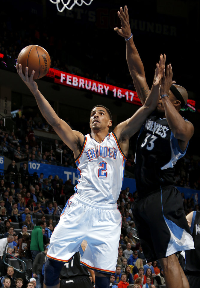 Photo - Oklahoma City's Thabo Sefolosha (2) goes past Minnesota's Dante Cunningham (33) during an NBA basketball game between the Oklahoma City Thunder and the Minnesota Timberwolves at Chesapeake Energy Arena in Oklahoma City, Wednesday, Jan. 9, 2013.  Photo by Bryan Terry, The Oklahoman