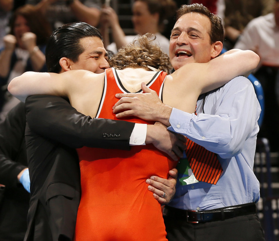 Photo - OSU's Alex Dieringer, middle, celebrates with assistant coach Eric Guerrero, left, and head coach John Smith after winning the championship at 157 pounds in the 2014 NCAA Div. I Wrestling Championships at Chesapeake Energy Arena in Oklahoma City, Saturday, March 22, 2014. Photo by Nate Billings, The Oklahoman