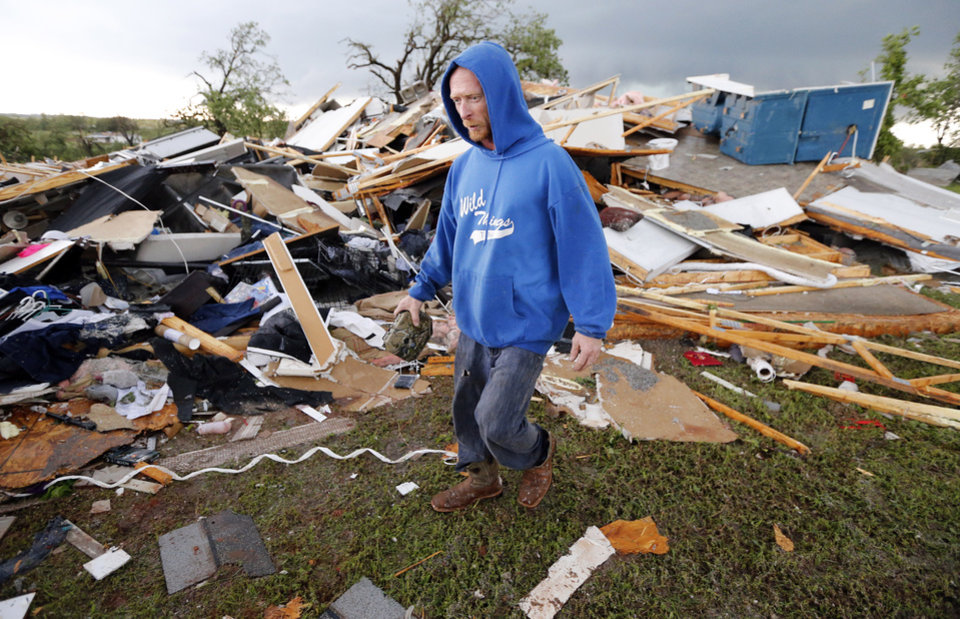 Photo - Jeff Stark looks over his home after a tornado ripped through Bridge Creek, Okla. on Wednesday, May 6, 2015.  Photo by Steve Sisney, The Oklahoman