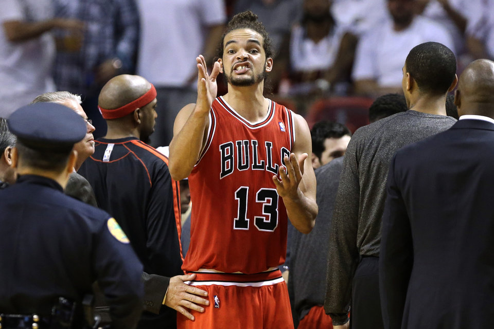 Chicago Bulls center Joakim Noah (13) reacts after a technical foul is called on guard Nate Robinson during the first half of Game 2 of their NBA basketball playoff series in the Eastern Conference semifinals against the Miami Heat, Wednesday, May 8, 2013, in Miami. (AP Photo/Lynne Sladky)