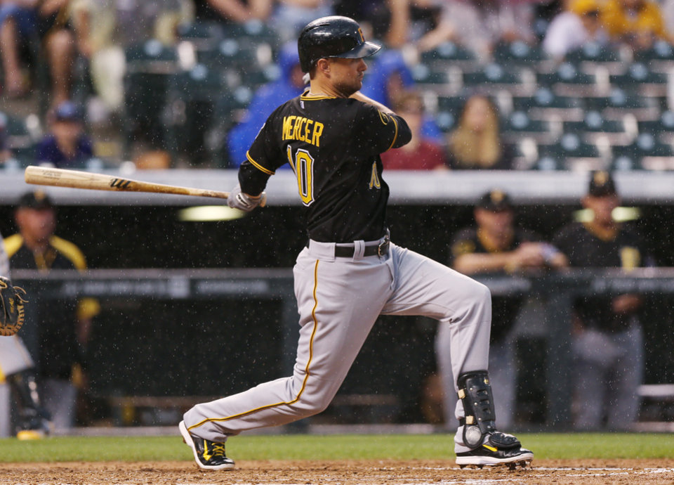 Photo - Pittsburgh Pirates' Jordy Mercer follows the flight of his leadoff double against the Colorado Rockies in the fourth inning of a baseball game in Denver, Saturday, July 26, 2014. (AP Photo/David Zalubowski)