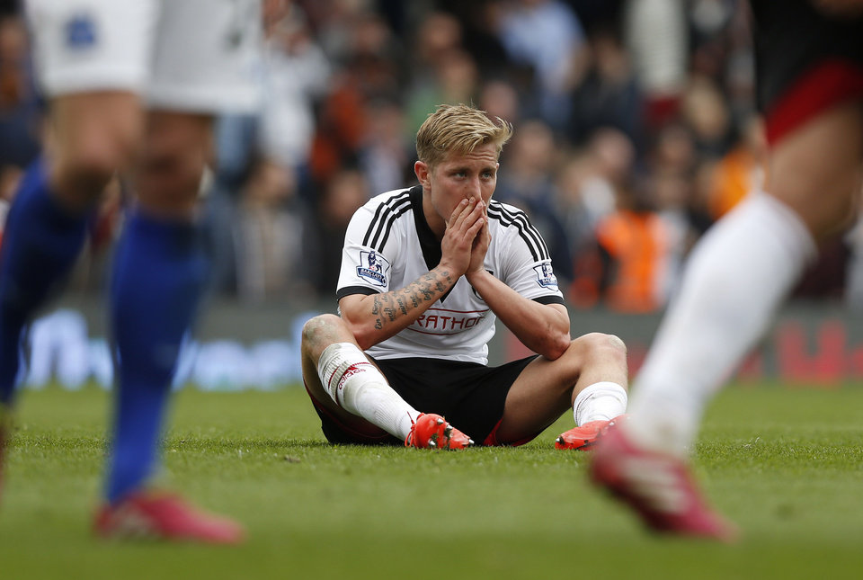 Photo - Fulham's Lewis Holtby sits dejected after his team lost to Everton, at the end of their English Premier League soccer match at Craven Cottage, London, Sunday, March 30, 2014. (AP Photo/Sang Tan)