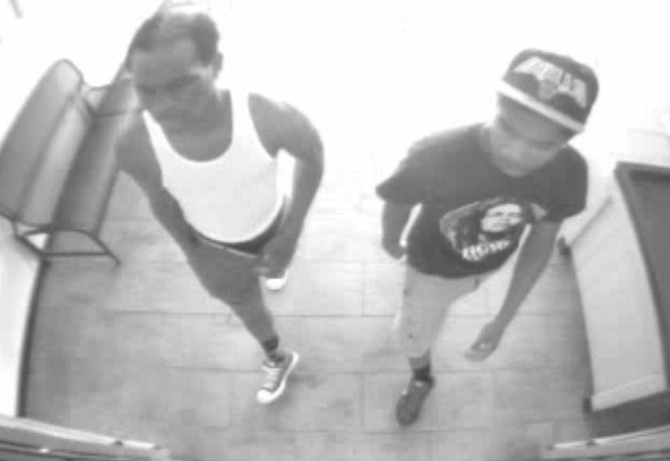 Photo - Surveillance footage at a business captured the images of two people suspected in the robbery of Oklahoma football coach Bob Stoops home.