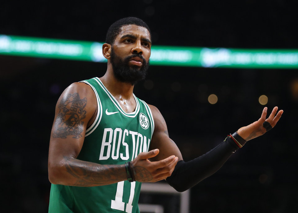 Photo - Boston Celtics guard Kyrie Irving (11) reacts to a call in the second half of an NBA basketball game against the Atlanta Hawks, Saturday, Jan. 19, 2019, in Atlanta. (AP Photo/Todd Kirkland)