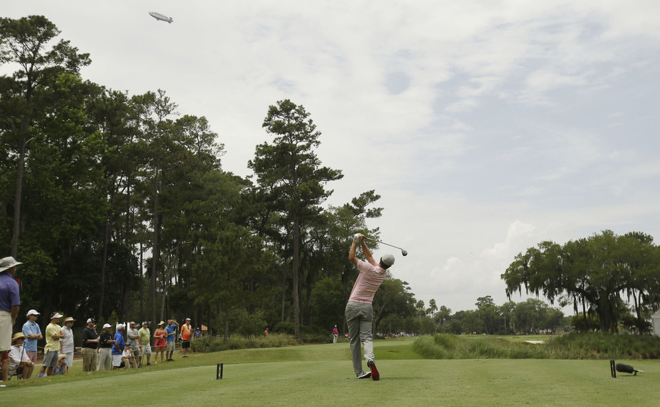 Photo - Justin Rose of England, hits from the ninth tee during the final round of The Players championship golf tournament at TPC Sawgrass, Sunday, May 11, 2014 in Ponte Vedra Beach, Fla. (AP Photo/Gerald Herbert)
